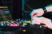 DJ hands on sound equipment — Stock Photo