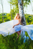 Girl wrapped in white fabric — Stock Photo