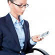 Business woman sitting on chair and looking at mobile phone — Stock Photo #11018006