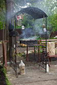 Cooking meat in barbecue — Stock Photo