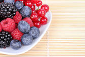 Assortment of berries on plate — Stock Photo