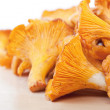 Stock Photo: Chanterelles on wooden table