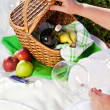 Enjoyng lunch, picnic outdoors - Stock Photo