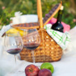 Outdoor picnic setting with red wine - Stock Photo