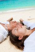 Loving couple on beach — Stock Photo