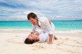 Lovely couple on beach — Stock Photo