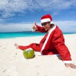 Santa Claus on beach relaxing - Stock Photo
