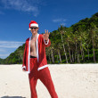 Santa in tropical summer - Stock Photo