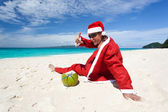 Santa Claus on beach relaxing — Stock Photo