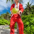 Santa under tropical palm — Stock Photo