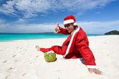 Santa Claus on beach relaxing — Stock Photo