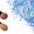 Crushed eyeshadows with brush — Stock Photo