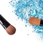 Crushed eyeshadows with brush — Stock Photo #15643323