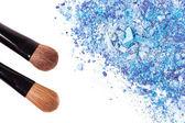 Crushed eyeshadows with brush — Stock Photo
