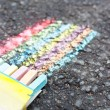 Set of colorful chalk  on asphalt - Stock Photo