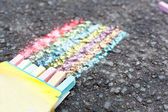 Set of colorful chalk on asphalt — Stock Photo