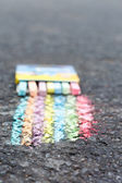 Set of colorful chalk on asphalt — 图库照片