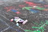 Colorful chalks on asphalt — Stock Photo