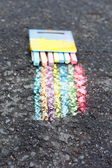 Set of colorful chalk on asphalt — Photo