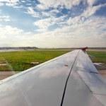 Airplane on landing strip — Stock Photo #18559933