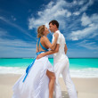 Loving wedding couple on beach — Stock Photo