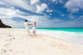 Loving wedding couple on beach — Stock Photo