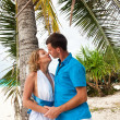 Royalty-Free Stock Photo: Loving wedding couple kissing under the palm