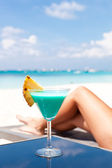 Resort Vacation. Woman relaxing with Blue Curacao Cocktail — Stock Photo