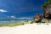 Tropical beach with rocks — Stock Photo