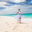 Royalty-Free Stock Photo: Happy bride dancing on beach