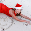 Happy woman in Santa hat on tropic beach  — Stock Photo