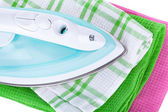 Electric iron and clothes — Stock Photo