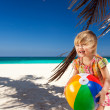 Little girl playing on beach with ball — Stock Photo
