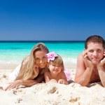 Happy family on tropic vacation — Stock Photo #24638605