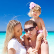 Happy family on tropic vacation — Stock Photo