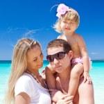 Happy family on tropic vacation — Stock Photo #24654511