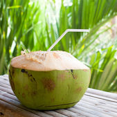 Fresh green coconut on table — Stock Photo