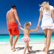 Happy family on tropic vacation - Stok fotoğraf