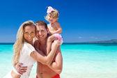 Happy family on tropic vacation — Stock Photo