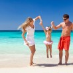 Happy family having fun on beach — Stock Photo