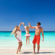 Happy family having fun on beach — Stock Photo