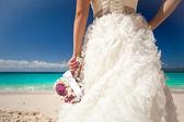 Wedding bouquet in bride's hand — Stock Photo