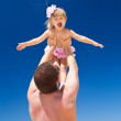 Happy father and little child on beach — Stock Photo