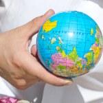 Globe in hand — Stock Photo