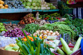 Fresh vegetables and fruits on market — Stock Photo