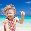 Happy little girl on the beach  — Stock Photo
