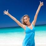 Happy blond girl on beach, feeling freedom. — Stock Photo #34364959