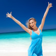 Happy blond girl on beach, feeling freedom. — Stock Photo #34364969