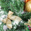 Decoration golden billow on new year tree branch — Stock Photo #35792709