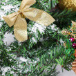 Decoration golden billow on new year tree branch — Foto Stock